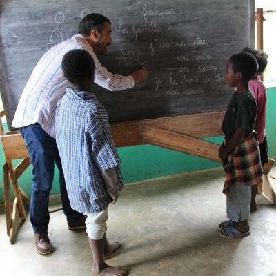 Students have group lessons with the volunteer teaching in Madagascar.